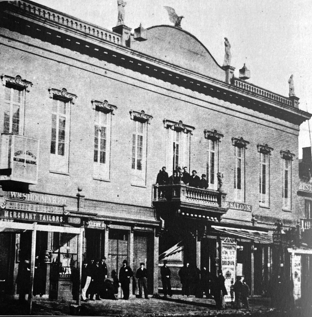 Photograph of patrons on the oudoor balcony at The National in the 1860s or 1870s.