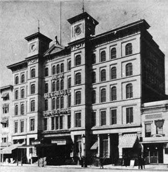 Photograph of National Theatre in 1885 with two towers on the facade of the five story building.