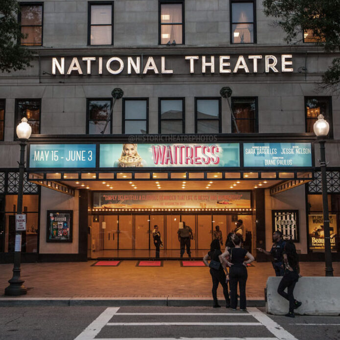 National Theatre marquee at night advertising the show Waitress.