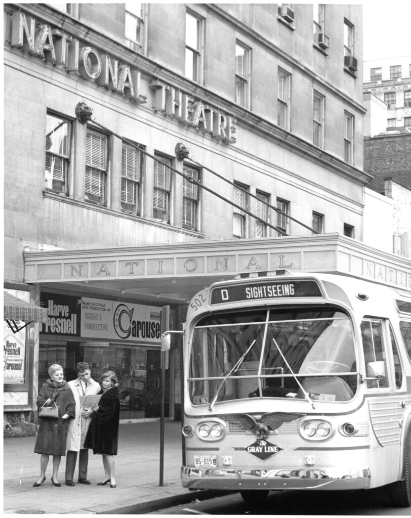 Photograph of a bus outside of The National.