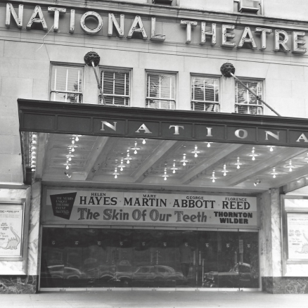 The National Theatre marquee with a banner for the production The Skin of Our Teeth