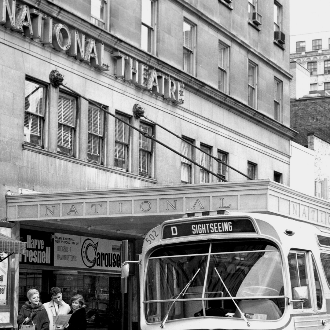 A black and white historic image of the exterior of The National Theatre