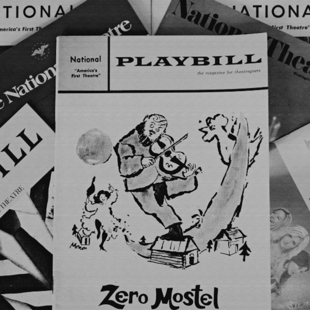 A stack of National Theatre Playbills